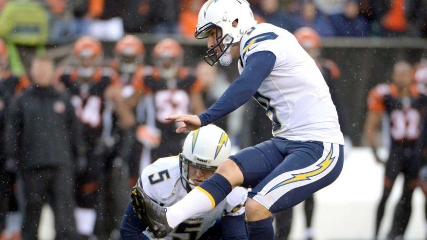 Jan 5, 2014; Cincinnati, OH, USA; San Diego Chargers kicker Nick Novak (9) attempts an extra point out of the hold of Mike Scifres (5) during the 2013 AFC wild card playoff football game against the Cincinnati Bengals at Paul Brown Stadium. The Chargers defeated the Bengals 27-10. Mandatory Credit: Kirby Lee-USA TODAY Sports