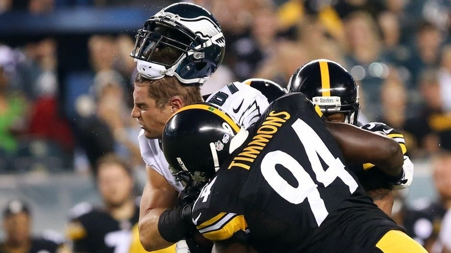 Aug 21, 2014; Philadelphia, PA, USA; Philadelphia Eagles tight end Brent Celek (87) makes a catch and has his helmet knocked off by Pittsburgh Steelers inside linebacker Lawrence Timmons (94) during the first quarter of a game at Lincoln Financial Field. Mandatory Credit: Bill Streicher-USA TODAY Sports