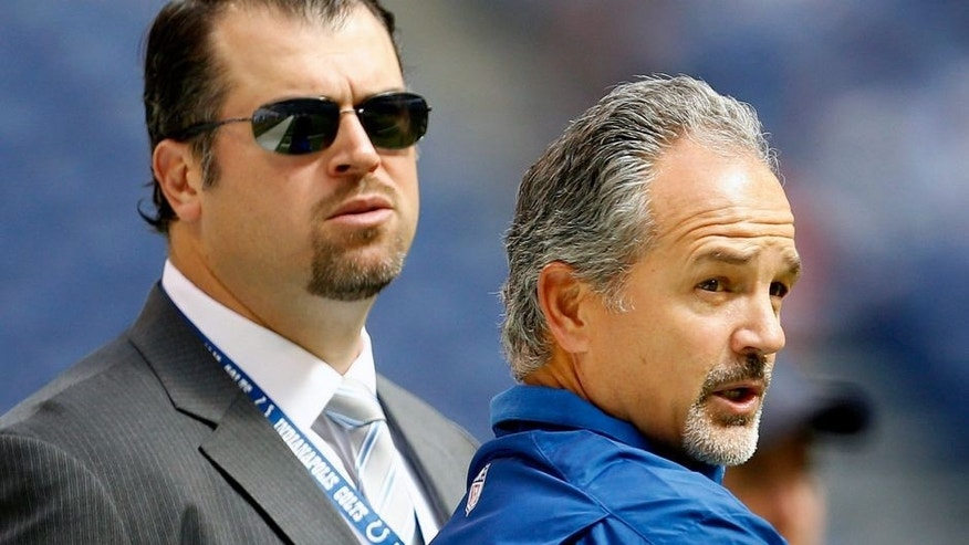 Indianapolis Colts head coach Chuck Pagano talks with Colts GM Ryan Grigson before the game. The Colts and the Dolphins warm up before first-half action at Lucas Oil Stadium in Indianapolis, Indiana, Sunday, September 15, 2013. (Sam Riche/MCT via Getty Images)