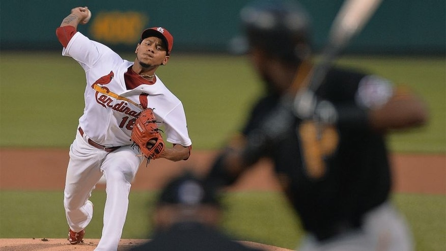 ST. LOUIS, MO - SEPTEMBER 4: Carlos Martinez #18 of the St. Louis Cardinals pitches against the Pittsburgh Pirates first inning at Busch Stadium on September 4, 2015 in St. Louis, Missouri. (Photo by Michael Thomas/Getty Images)