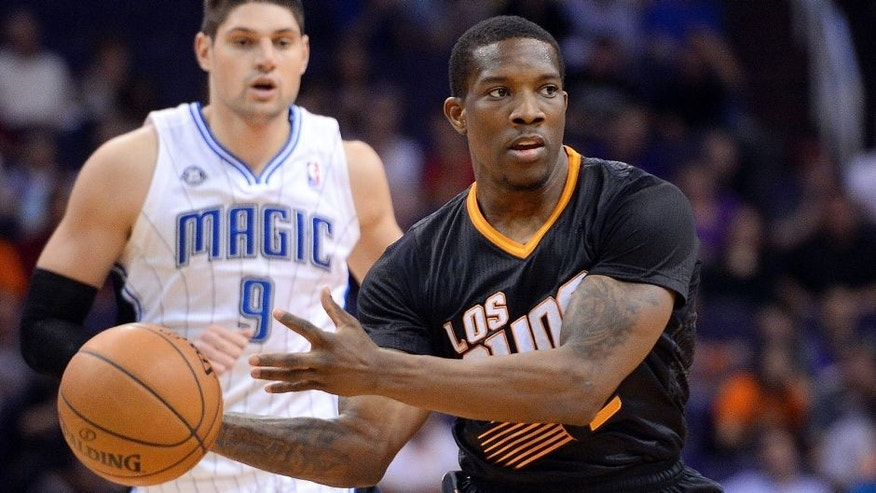 Mar 19, 2014; Phoenix, AZ, USA; Phoenix Suns guard Eric Bledsoe (2) makes a pass against the Orlando Magic in the first half at US Airways Center. Mandatory Credit: Joe Camporeale-USA TODAY Sports