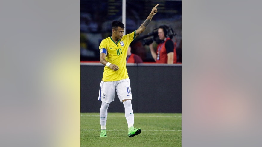 Brazil's Neymar celebrates his goal on a penalty kick against the United States during the second half of a friendly soccer match Tuesday, Sept. 8, 2015, in Foxborough, Mass. (AP Photo/Stephan Savoia)