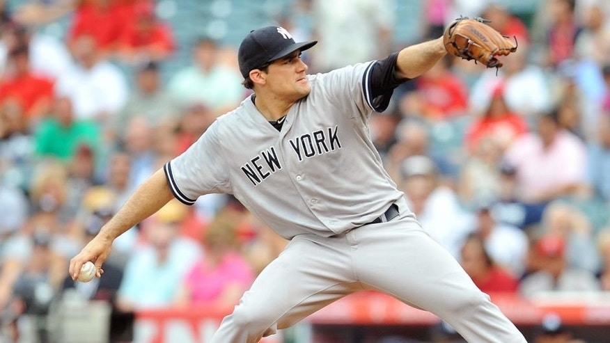 July 1, 2015; Anaheim, CA, USA; New York Yankees starting pitcher Nathan Eovaldi (30) pitches the first inning against the Los Angeles Angels at Angel Stadium of Anaheim. Mandatory Credit: Gary A. Vasquez-USA TODAY Sports