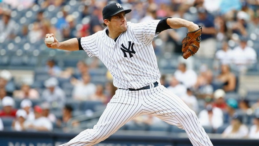 NEW YORK, NY - AUGUST 19: Nathan Eovaldi #30 of the New York Yankees pitches against the Minnesota Twins during their game at Yankee Stadium on August 19, 2015 in New York City. (Photo by Al Bello/Getty Images)