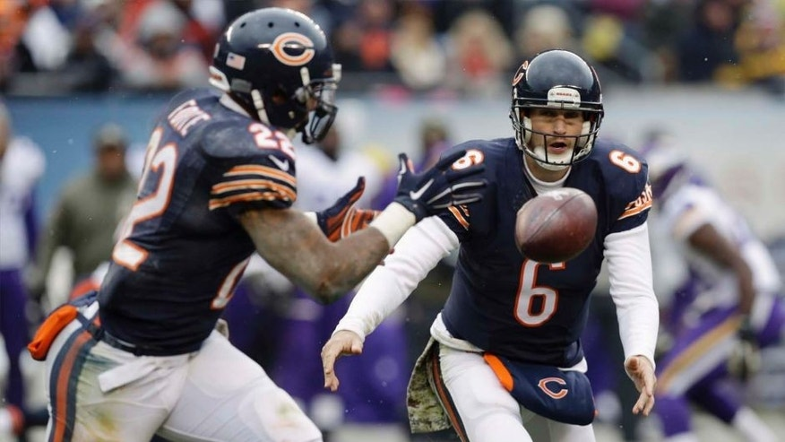 Chicago Bears quarterback Jay Cutler (right) tpitches the ball out to running back Matt Forte during the first half.