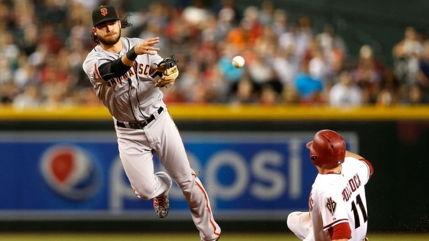 PHOENIX, AZ - SEPTEMBER 07: Infielder Brandon Crawford #35 of the San Francisco Giants throws over the sliding A.J. Pollock #11 of the Arizona Diamondbacks to complete a double play during the first inning of the MLB game at Chase Field on September 7, 2015 in Phoenix, Arizona. (Photo by Christian Petersen/Getty Images)