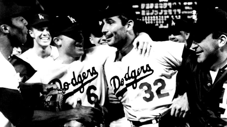 LOS ANGELES, CA - SEPTEMBER 9: Pitcher Sandy Koufax #32 of the Los Angeles Dodgers is mobbed by teammates Willie Davis #3, Wes Parker #28, Ron Fairly #6 and Don LeJohn #31 after pitching a perfect game against the Chicago Cubs on September 9, 1965 at Dodger Stadium in Los Angeles, California. This would be Koufax's 4th no-hitter and only perfect game. (Photo by B Bennett/Getty Images)