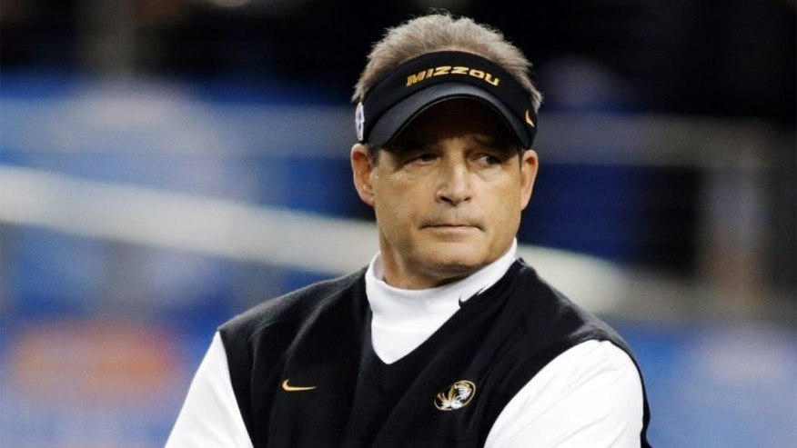 Jan 3, 2014; Arlington, TX, USA; Missouri Tigers head coach Gary Pinkel on the field before the game against the Oklahoma State Cowboys at the 2014 Cotton Bowl at AT&T Stadium. Mandatory Credit: Tim Heitman-USA TODAY Sports