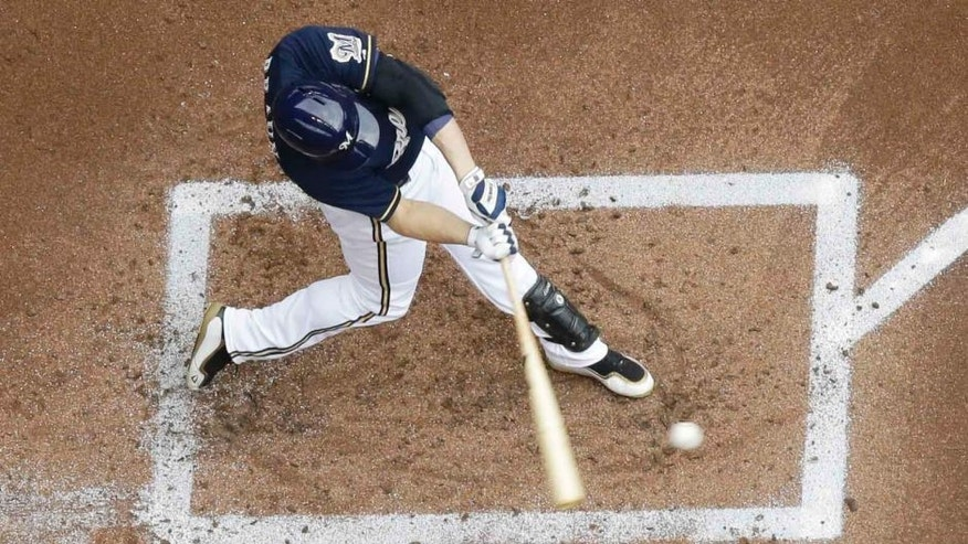 Sunday, Aug. 30: The Milwaukee Brewers' Ryan Braun hits a home run during the first inning against the Cincinnati Reds in Milwaukee. The Brewers won 4-1.