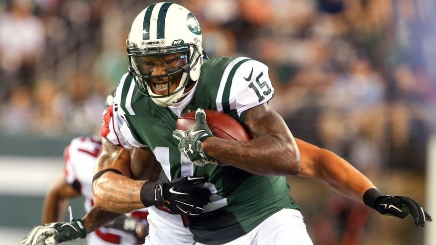 Aug 21, 2015; East Rutherford, NJ, USA; New York Jets wide receiver Brandon Marshall (15) runs with the ball during the first half of their game against the Atlanta Falcons at MetLife Stadium. Mandatory Credit: Ed Mulholland-USA TODAY Sports