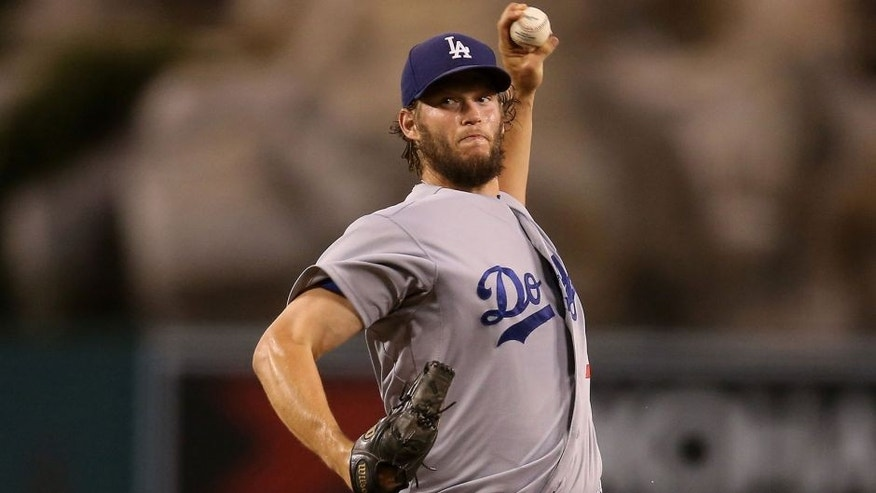 ANAHEIM, CA - SEPTEMBER 08: Clayton Kershaw #22 of the Los Angeles Dodgers throws a pitch against the Los Angeles Angels of Anaheim at Angel Stadium of Anaheim on September 8, 2015 in Anaheim, California. (Photo by Stephen Dunn/Getty Images)