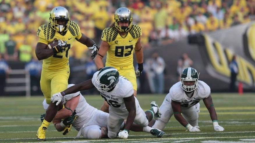 Sep 6, 2014; Eugene, OR, USA; Oregon Ducks running back Royce Freeman (21) runs the ball against the Michigan State Spartans at Autzen Stadium. Mandatory Credit: Scott Olmos-USA TODAY Sports