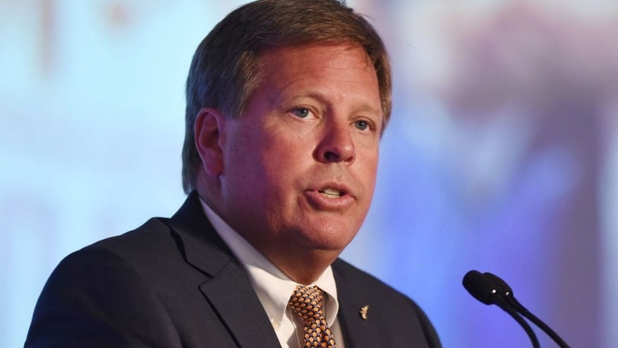 Jul 13, 2015; Hoover, AL, USA; Florida Gators football coach Jim McElwain fields questions during SEC media days at the Wynfrey Hotel. Mandatory Credit: Kelly Lambert-USA TODAY Sports