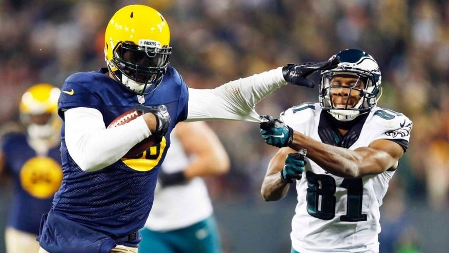 The Green Bay Packers' Julius Peppers (left) gets away from the Philadelphia Eagles' Jordan Matthews after intercepting a pass and running it back for a touchdown during the second half.