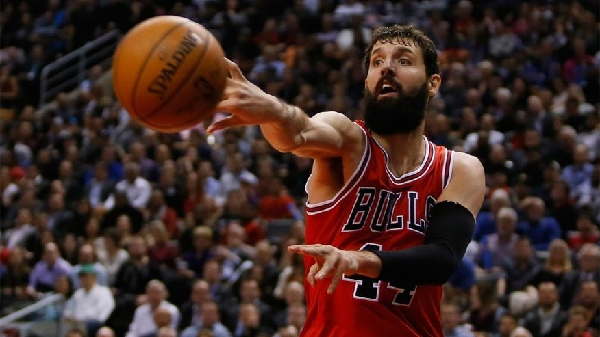 Mar 25, 2015; Toronto, Ontario, CAN; Chicago Bulls forward Nikola Mirotic (44) passes the ball against the Toronto Raptors at the Air Canada Centre. Chicago defeated Toronto 116-103. Mandatory Credit: John E. Sokolowski-USA TODAY Sports