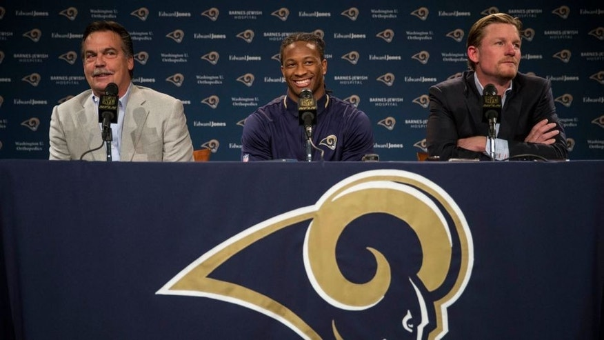 St. Louis Rams head coach Jeff Fisher, left, and general manager Les Snead, right, introduce first-round draft pick Todd Gurley during a news conference at the NFL football team's practice facility Friday, May 1, 2015, in St. Louis. Gurley, a running back from Georgia, was picked tenth overall by the Rams. (AP Photo/Whitney Curtis)