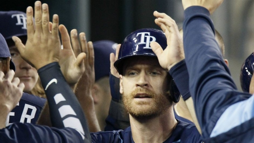 <p>Tampa Bay Rays' Logan Forsythe celebrates in the dugout after scoring against the Detroit Tigers during the fourth inning of a baseball game Wednesday, Sept. 9, 2015, in Detroit. (AP Photo/Duane Burleson)</p>