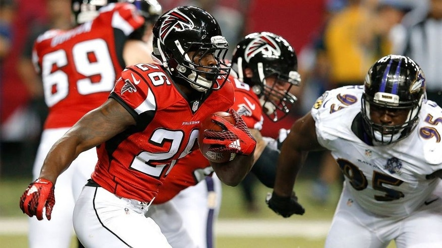 ATLANTA, GA - SEPTEMBER 03: Tevin Coleman #26 of the Atlanta Falcons rushes against the Baltimore Ravens at Georgia Dome on September 3, 2015 in Atlanta, Georgia. (Photo by Kevin C. Cox/Getty Images)