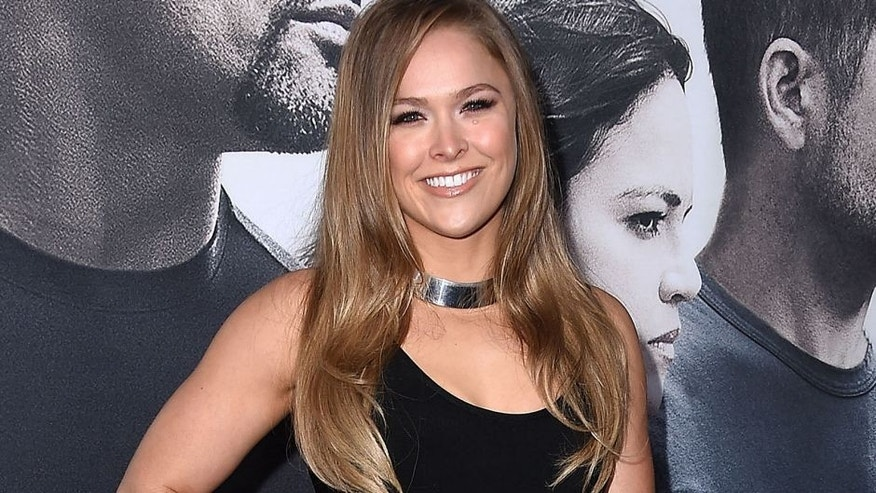 "HOLLYWOOD, CA - APRIL 01: Ronda Rousey arrvies at the ""Furious 7"" - Los Angeles Premiere at TCL Chinese Theatre IMAX on April 1, 2015 in Hollywood, California. (Photo by Steve Granitz/WireImage)"