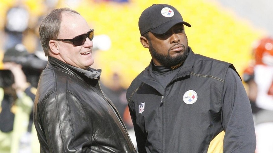 December 4, 2011; Pittsburgh,PA, USA: Pittsburgh Steelers director of football operations Kevin Colbert (left) talks with Steelers head coach Mike Tomlin (right) on the field before playing against the Cincinnati Bengals at Heinz Field. The Steelers won 35-7. Mandatory Credit: Charles LeClaire-USPRESSWIRE