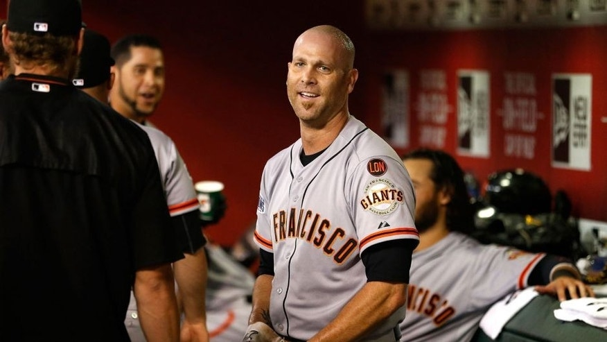PHOENIX, AZ - SEPTEMBER 08: Tim Hudson #17 of the San Francisco Giants reacts in the duogut after hitting a solo home-run against the Arizona Diamondbacks during the third inning of the MLB game at Chase Field on September 8, 2015 in Phoenix, Arizona. (Photo by Christian Petersen/Getty Images)