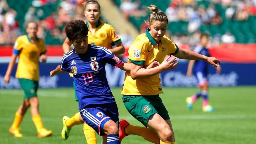 EDMONTON, AB - JUNE 27: Saori Ariyoshi #19 of Japan against Larissa Crummer #2 of Australia during the FIFA Women's World Cup Canada 2015 Quarter Final match between Australia and Japan at Commonwealth Stadium on June 27, 2015 in Edmonton, Canada. (Photo by Kevin C. Cox/Getty Images)
