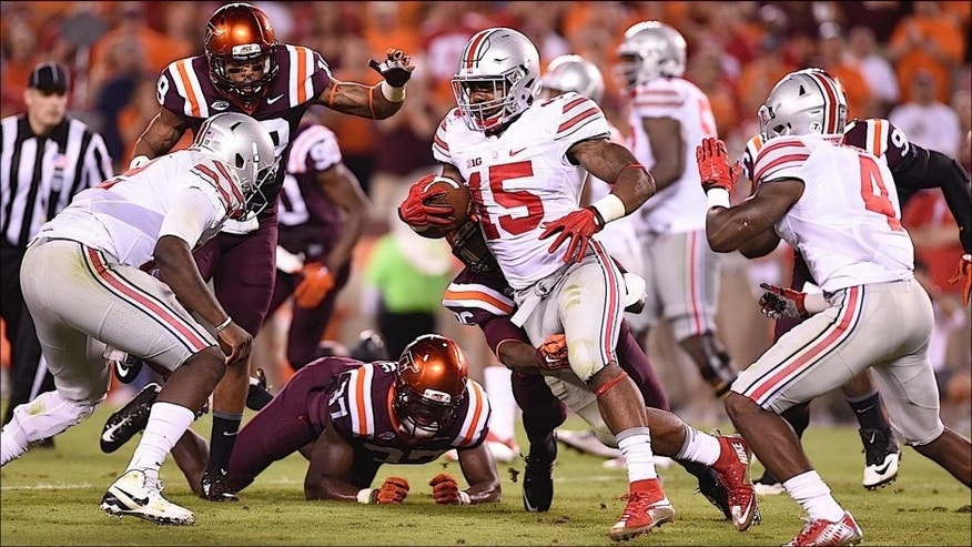 <p>Sep 7, 2015; Blacksburg, VA, USA; Ohio State Buckeyes running back Ezekiel Elliott (15) with the ball in the third quarter at Lane Stadium. Mandatory Credit: Bob Donnan-USA TODAY Sports</p>