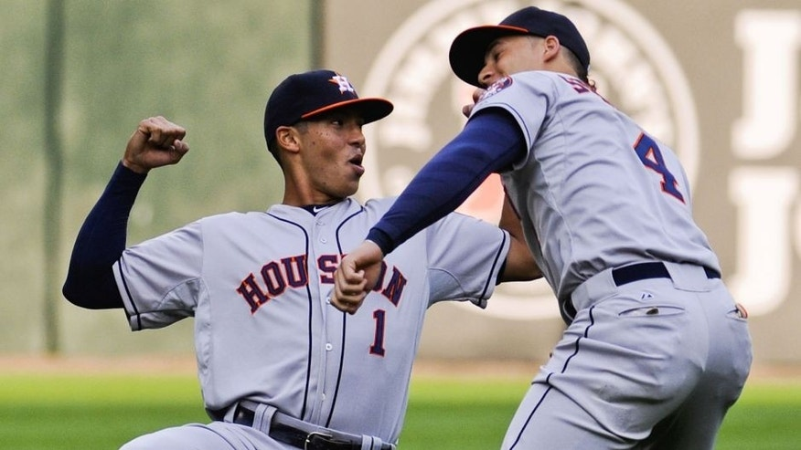Jun 8, 2015; Chicago, IL, USA; Houston Astros shortstop Carlos Correa (1) warms up with Houston Astros right fielder George Springer (4) before the game against the Chicago White Sox at U.S Cellular Field. Mandatory Credit: Matt Marton-USA TODAY Sports