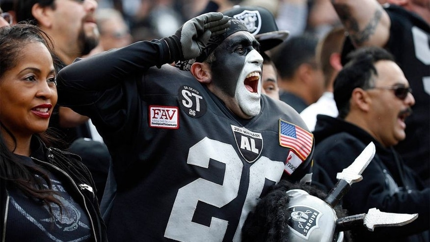 Nov 3, 2013; Oakland, CA, USA; Oakland Raiders fans in the Black Hole cheer the action of the field during the first quarter against the Philadelphia Eagles at O.co Coliseum. Mandatory Credit: Bob Stanton-USA TODAY Sports