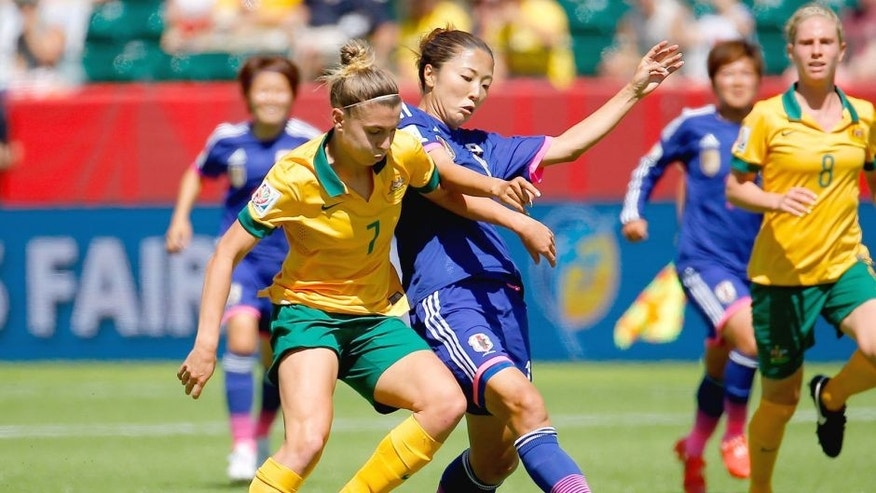 EDMONTON, AB - JUNE 27: Steph Catley #7 of Australia challenges Yuki Ogimi #17 of Japan during the FIFA Women's World Cup Canada 2015 Quarter Final match between Australia and Japan at Commonwealth Stadium on June 27, 2015 in Edmonton, Canada. (Photo by Kevin C. Cox/Getty Images)