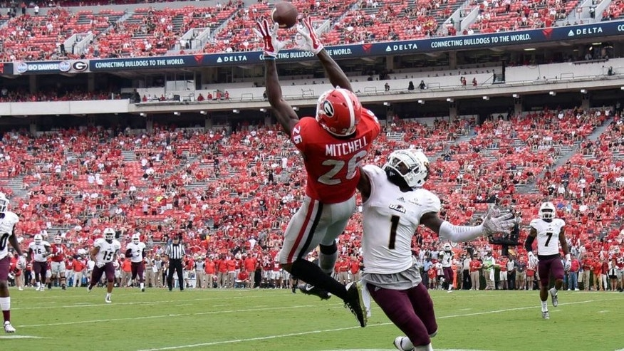 Sep 5, 2015; Athens, GA, USA; Georgia Bulldogs wide receiver Malcolm Mitchell (26) catches a touchdown pass defended by Louisiana Monroe Warhawks cornerback Lenzy Pipkins (1) during the second half at Sanford Stadium. Georgia defeated Louisiana Monroe 51-14 in a game shortened by thunder storms. Mandatory Credit: Dale Zanine-USA TODAY Sports