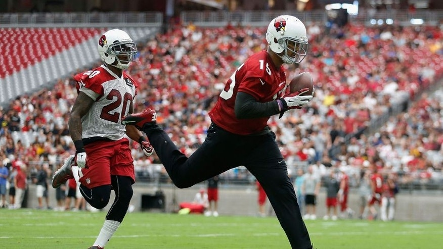GLENDALE, AZ - AUGUST 01: Wide receiver Michael Floyd #15 of the Arizona Cardinals makes a reception past strong safety Deone Bucannon #20 during the team training camp at University of Phoenix Stadium on August 1, 2015 in Glendale, Arizona. (Photo by Christian Petersen/Getty Images)