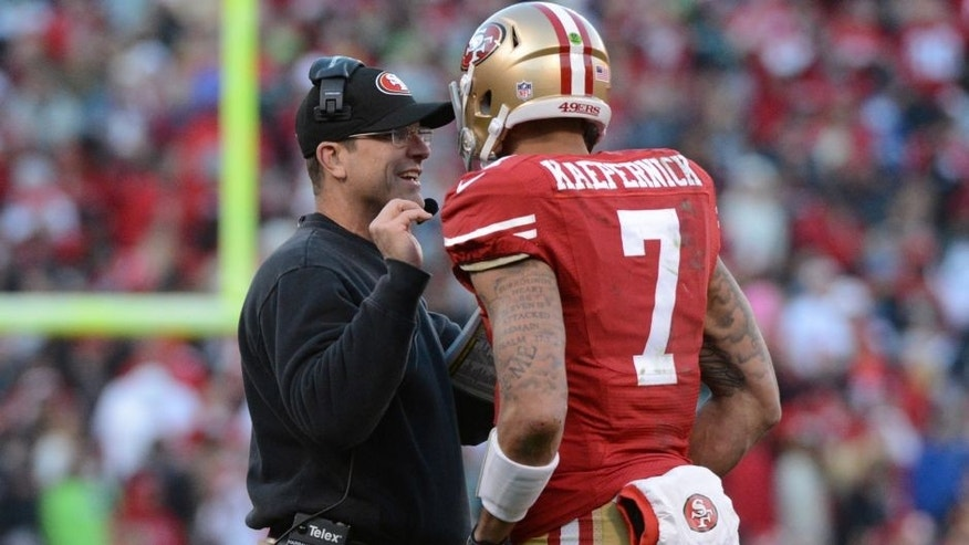 <p>December 8, 2013; San Francisco, CA, USA; San Francisco 49ers head coach Jim Harbaugh (left) instructs quarterback Colin Kaepernick (7) during the fourth quarter against the Seattle Seahawks at Candlestick Park. The 49ers defeated the Seahawks 19-17. Mandatory Credit: Kyle Terada-USA TODAY Sports</p>