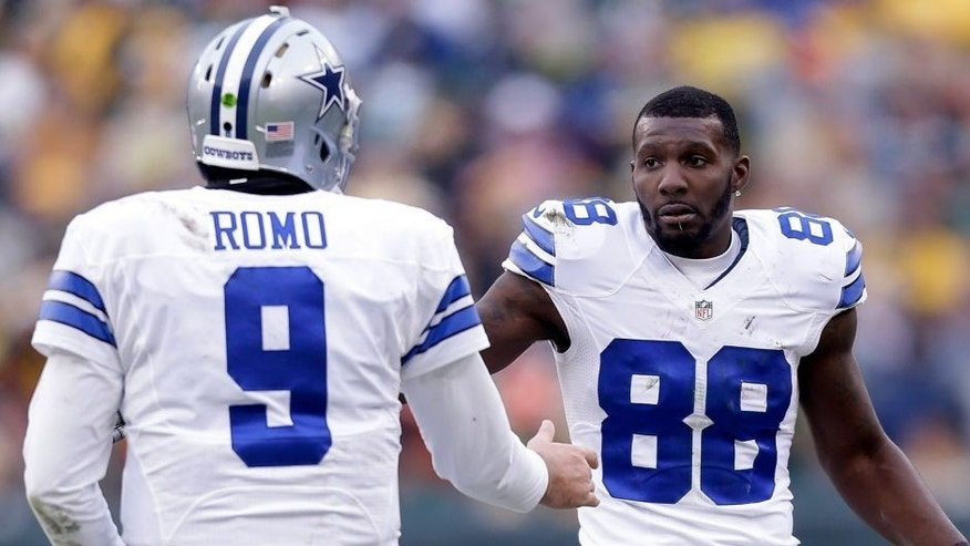 GREEN BAY, WI - JANUARY 11: Tony Romo #9 and Dez Bryant #88 of the Dallas Cowboys wait for an officials' review during the 2015 NFC Divisional Playoff game at Lambeau Field on January 11, 2015 in Green Bay, Wisconsin. (Photo by Mike McGinnis/Getty Images)