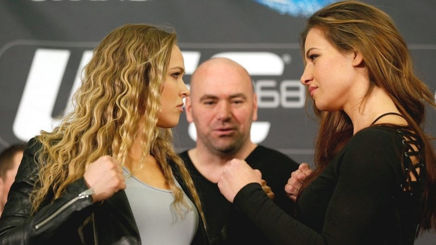 LAS VEGAS, NV - DECEMBER 26: (L-R) Opponents Ronda Rousey and Miesha Tate face off during the UFC 168 pre-fight press conference at the MGM Grand Hotel/Casino on December 26, 2013 in Las Vegas, Nevada. (Photo by Josh Hedges/Zuffa LLC/Zuffa LLC via Getty Images)