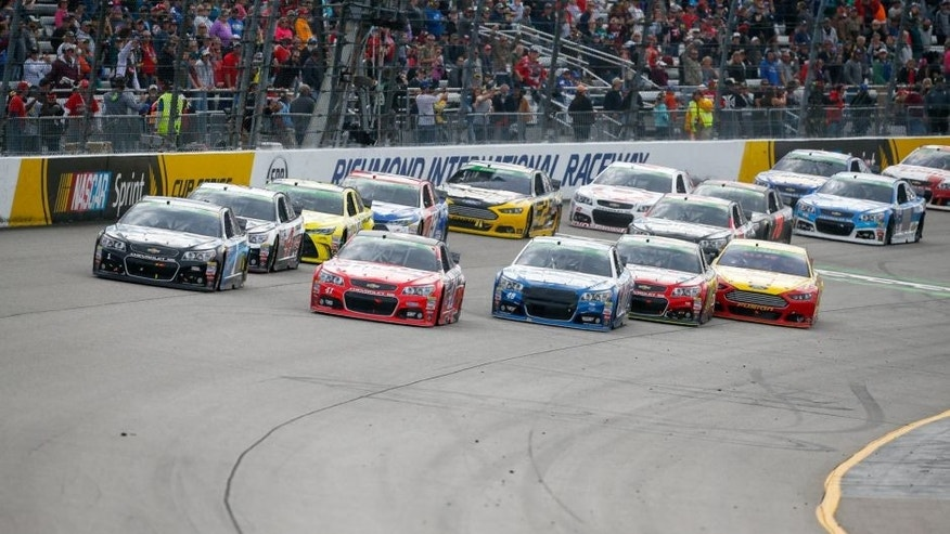 Kurt Busch, driver of the #41 Haas Automation Chevrolet, leads a pack of cars during the NASCAR Sprint Cup Series Toyota Owners 400 at Richmond International Raceway on April 26, 2015 in Richmond, Virginia.