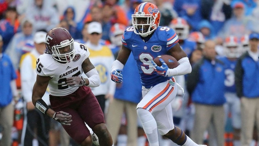 GAINESVILLE, FL - NOVEMBER 22: Latroy Pittman, Jr. #9 of the Florida Gators is defended by Chris Owens #25 of the Eastern Kentucky Colonels during the game at Ben Hill Griffin Stadium on November 22, 2014 in Gainesville, Florida. (Photo by Rob Foldy/Getty Images)