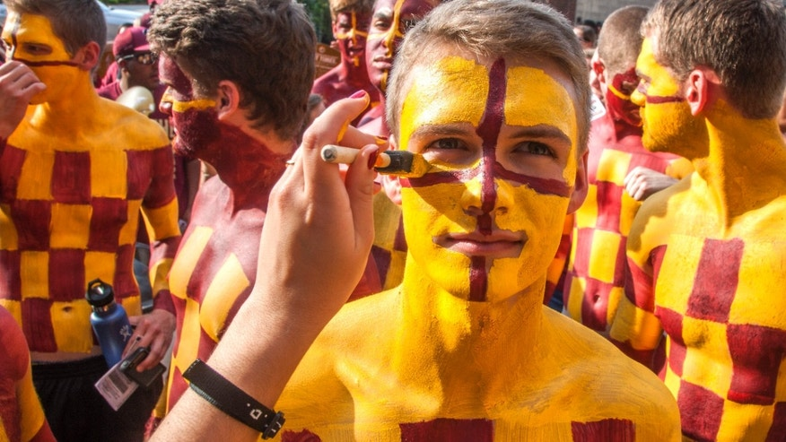 Sept. 5, 2015: Florida State fan Kyle Hill has his face painted while he waits in line for an NCAA college football game between Florida State and Texas State in Tallahassee, Fla.