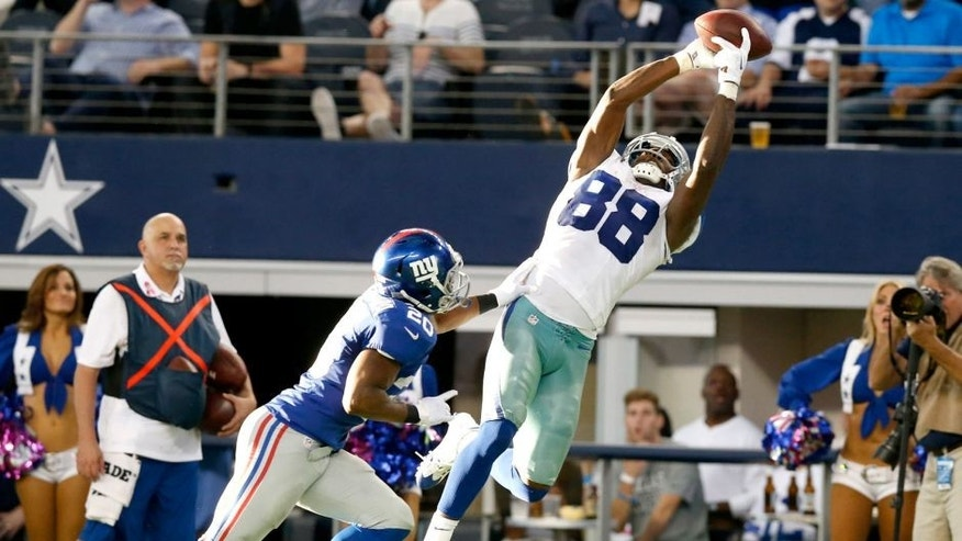 Oct 19, 2014; Arlington, TX, USA; Dallas Cowboys receiver Dez Bryant (88) makes a catch in the fourth quarter against New York Giants cornerback Prince Amukamara (20) at AT&T Stadium. Mandatory Credit: Matthew Emmons-USA TODAY Sports