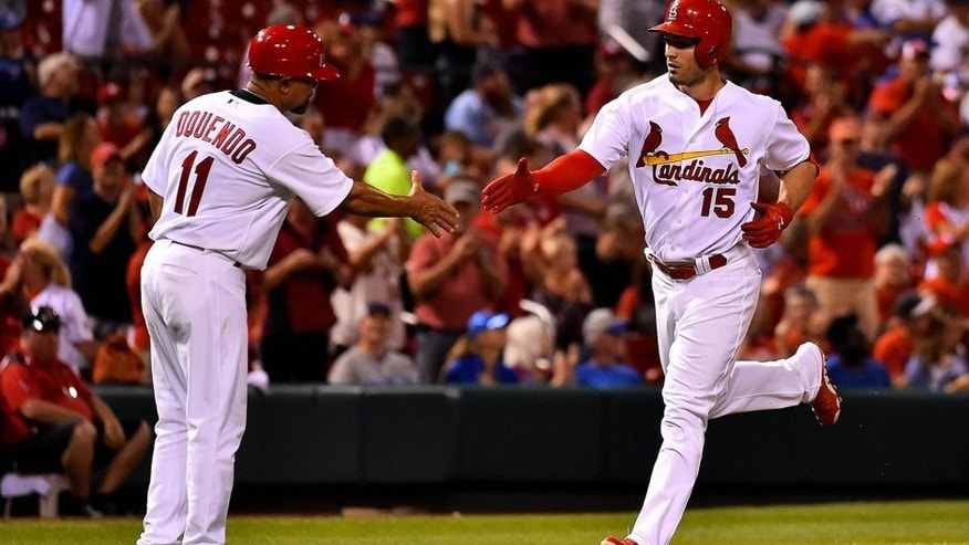 Sep 8, 2015; St. Louis, MO, USA; St. Louis Cardinals left fielder Randal Grichuk (15) celebrates with St. Louis Cardinals third base coach Jose Oquendo (11) after hitting a two-run home run against the St. Louis Cardinals at Busch Stadium. Mandatory Credit: Jasen Vinlove-USA TODAY Sports