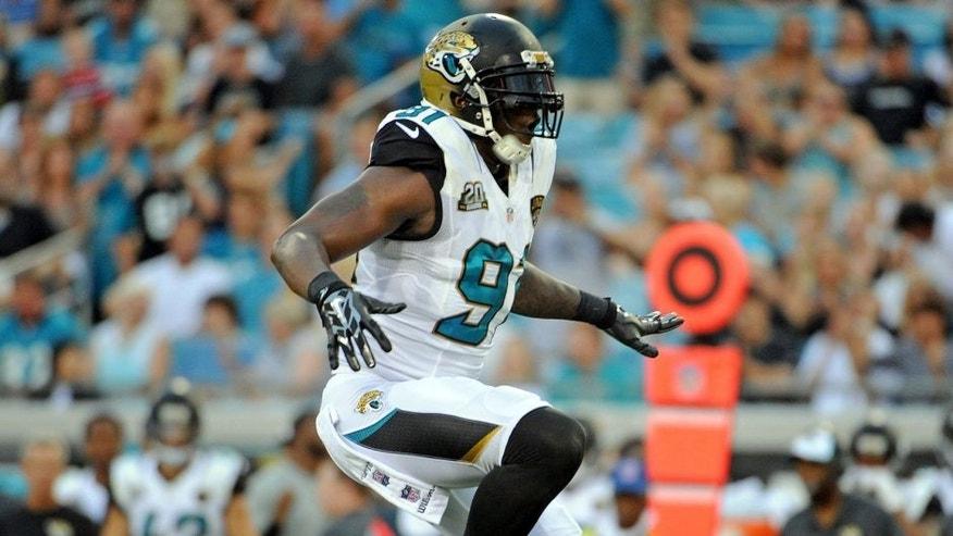 Aug 8, 2014; Jacksonville, FL, USA; Jacksonville Jaguars defensive end Chris Clemons (91) celebrates a sack during the first quarter of the game against the Tampa Bay Buccaneers at EverBank Field. Mandatory Credit: Melina Vastola-USA TODAY Sports