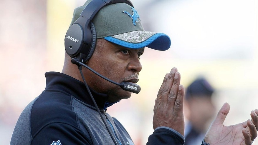 Nov 23, 2014; Foxborough, MA, USA; Detroit Lions head coach Jim Caldwell applauds his team during the second quarter against the New England Patriots at Gillette Stadium. Mandatory Credit: Stew Milne-USA TODAY Sports