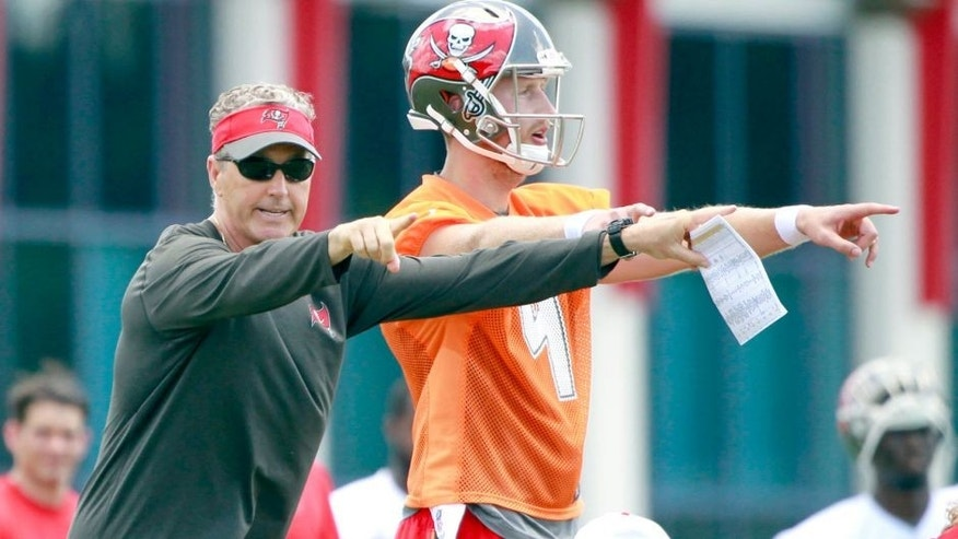 May 28, 2015; Tampa, FL, USA; Tampa Bay Buccaneers offensive coordinator Dirk Koetter and quarterback Seth Lobato (4) work out at One Buc Place. Mandatory Credit: Kim Klement-USA TODAY Sports