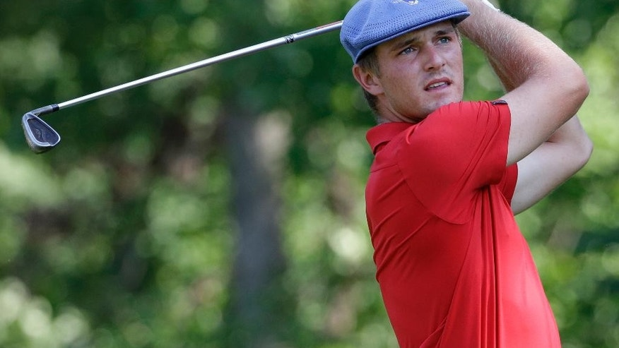 ADVANCE FOR WEEKEND EDITIONS, SEPT. 12-13 FILE - In this Aug. 23, 2015, file photo, Bryson DeChambeau watches his tee shot on the 25th hole during the championship match of the U.S. Amateur golf tournament at Olympia Fields Country Club in Olympia Fields, Ill. Bryson DeChambeau defeated Derek Bard 7 and 6.(AP Photo/Nam Y. Huh, File)
