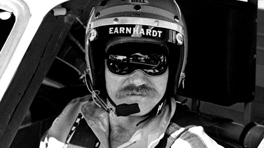 DAYTONA BEACH, FL - FEBRUARY 17, 1980: NASCAR driver Dale Earnhardt Sr. sits in his car at the Daytona International Speedway prior to the start of the 1980 Daytona 500 on February 17, 1980 in Daytona Beach, Florida. (Photo by Robert Alexander/Archive Photos/Getty Images)