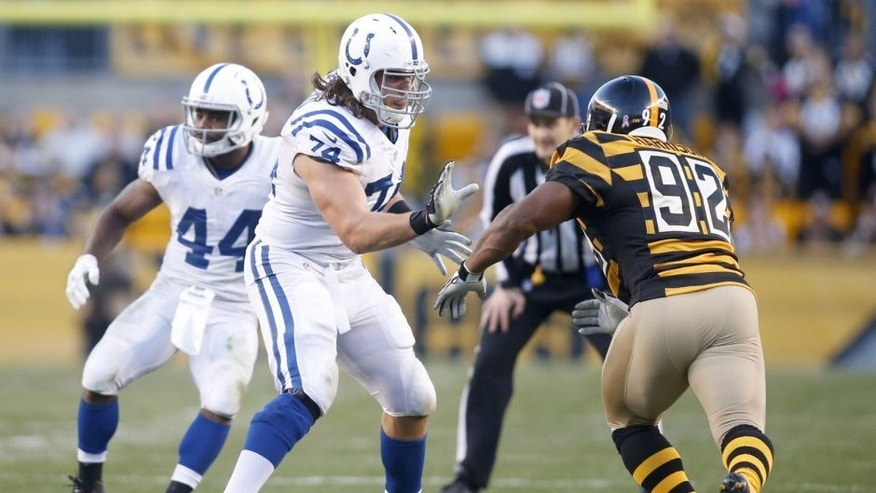 Oct 26, 2014; Pittsburgh, PA, USA; Indianapolis Colts tackle Anthony Castonzo (74) blocks at the line of scrimmage against Pittsburgh Steelers linebacker James Harrison (92) during the second quarter at Heinz Field. The Steelers won 51-34. Mandatory Credit: Charles LeClaire-USA TODAY Sports