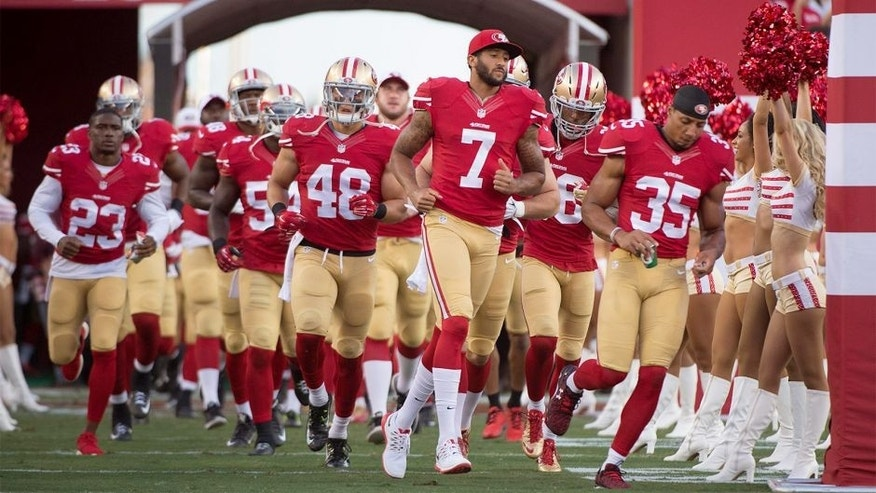 September 3, 2015; Santa Clara, CA, USA; San Francisco 49ers quarterback Colin Kaepernick (7) runs onto the field with his teammates before a preseason game against the San Diego Chargers at Levi's Stadium. The 49ers defeated the Chargers 14-12. Mandatory Credit: Kyle Terada-USA TODAY Sports