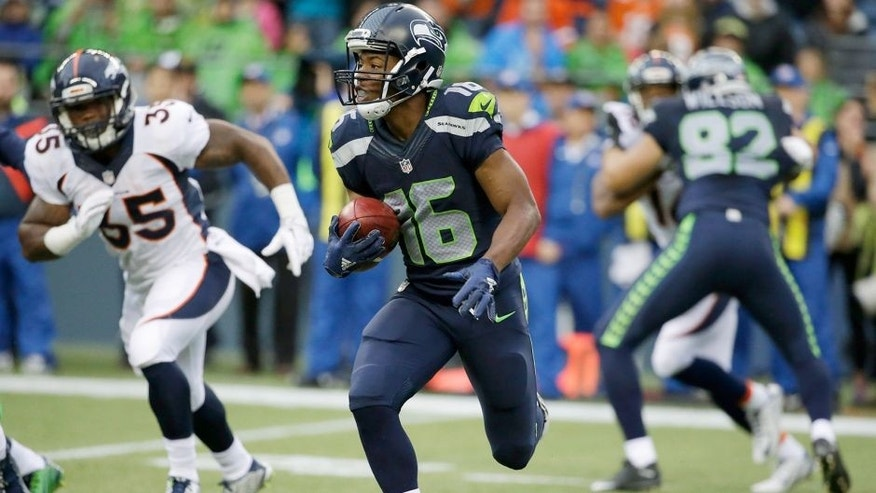 Seattle Seahawks' Tyler Lockett returns a kickoff 103 yards for a touchdown against the Denver Broncos during the first half of a preseason NFL football game, Friday, Aug. 14, 2015, in Seattle. (AP Photo/Elaine Thompson)