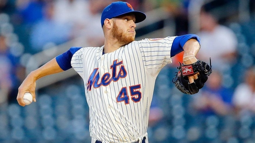 NEW YORK, NY - AUGUST 27: Zack Wheeler #45 of the New York Mets in action against the Atlanta Braves at Citi Field on August 27, 2014 in the Flushing neighborhood of the Queens borough of New York City. The Braves defeated the Mets 3-2. (Photo by Jim McIsaac/Getty Images) *** Local Caption *** Zack Wheeler