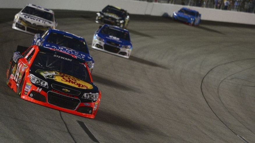 Greg Biffle, driver of the #16 3M Call Before You Dig Ford, leads Ryan Newman, driver of the #31 Caterpillar/ Chevrolet, during the NASCAR Sprint Cup Series Federated Auto Parts 400 at Richmond International Raceway on September 6, 2014 in Richmond, Virginia.